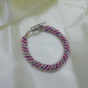 Jewelry - Pink, purple and silver hand beaded bracelet